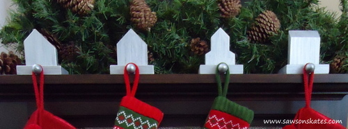 Four stocking holders on a fireplace