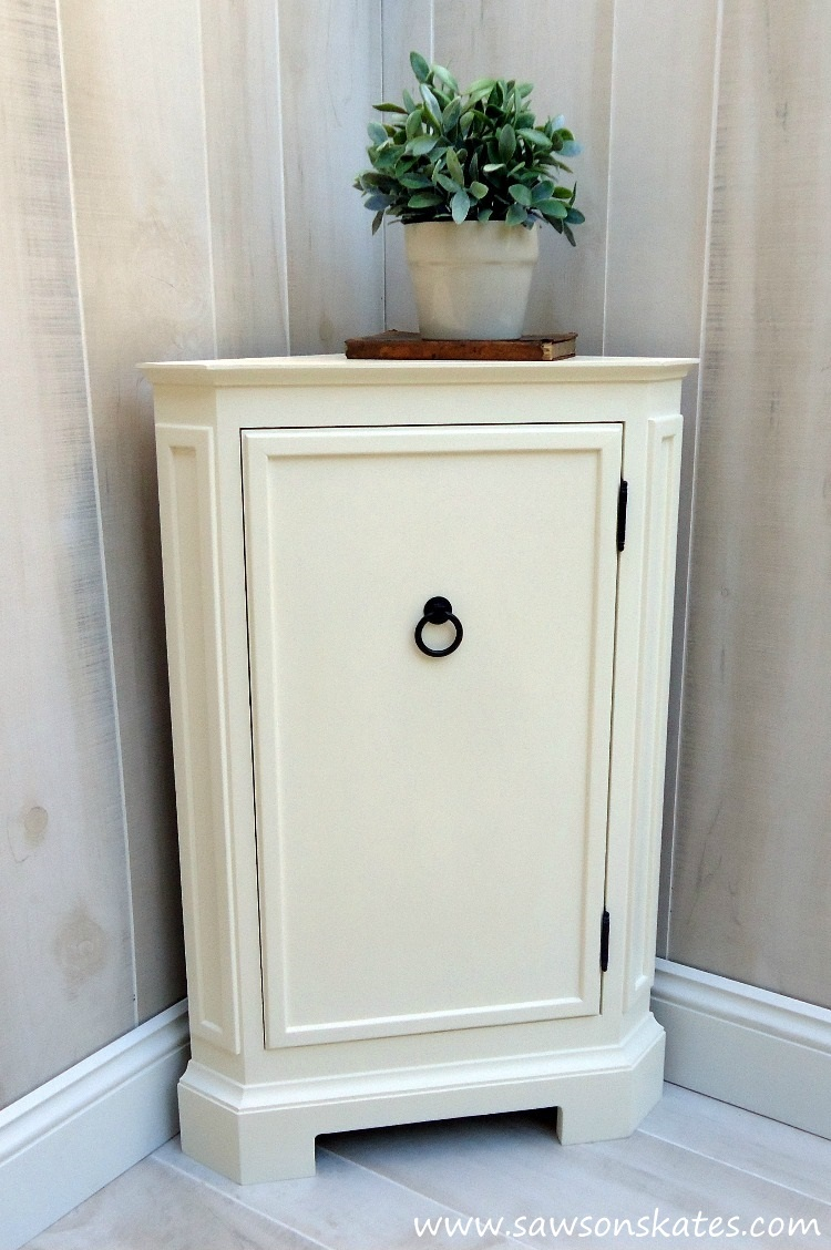 dLooking for storage ideas? Build this small DIY corner cabinet! It's great for the bathroom or anywhere you need a little extra storage. It was inspired by a catalog retailer and it's loaded with molding detail.