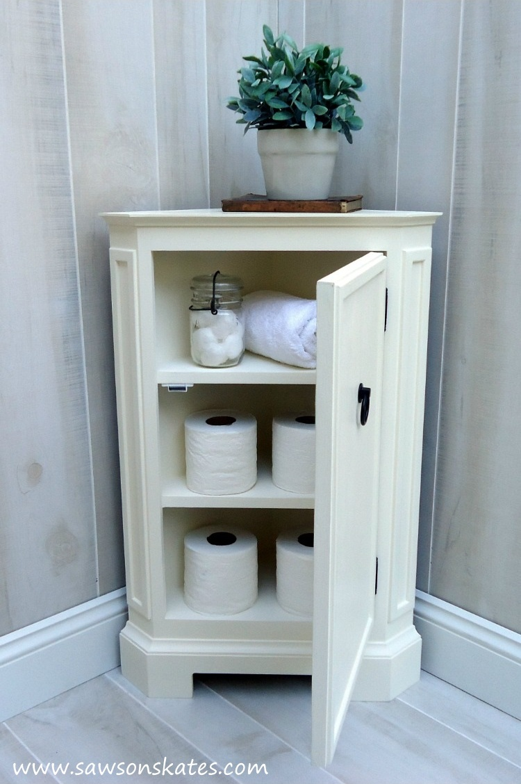 Looking for storage ideas? Build this small DIY corner cabinet! It's great for the bathroom or anywhere you need a little extra storage. It was inspired by a catalog retailer and it's loaded with molding detail.