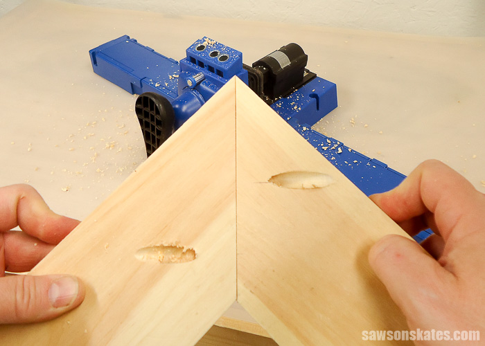Drilling pocket holes on miter joints - Rather than drilling pocket holes on one side of the miter joint, pocket holes are drilled on both sides of the miter joint. First, cut your miter joint. Place the joint together. Mark one side near the toe and one side near the heel.