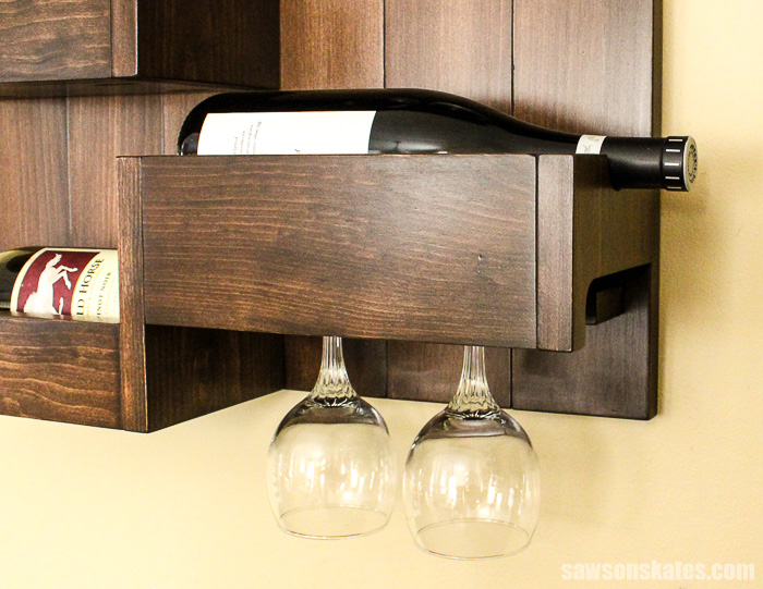 Wall-mounted DIY wine bar - the wine glasses load from the sid