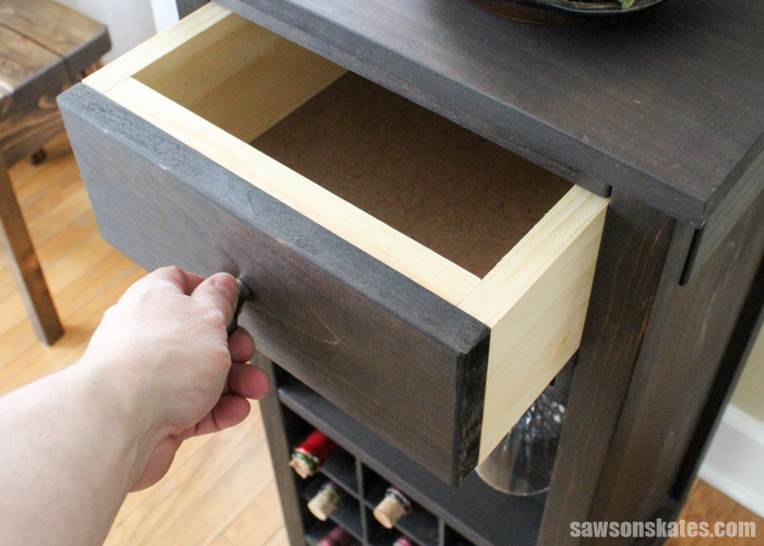 The DIY wine cabinet also features a storage drawer for wine accessories like bottle openers, etc. There are no drawer slides, so the drawer is super easy to build.
