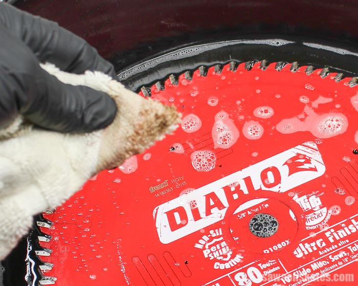 Wiping off the saw blade cleaner