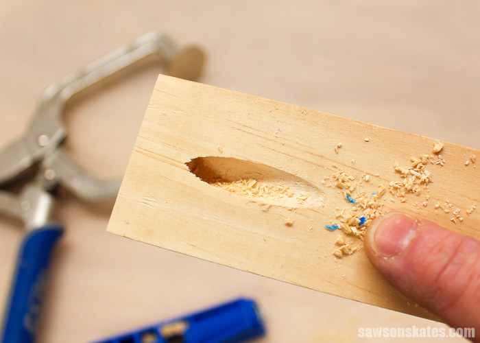 It's not uncommon to see some blue plastic shavings when drilling your first few pocket holes with the Kreg Jig Mini.