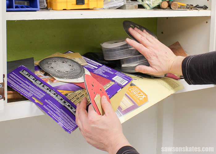 Sandpaper Storage Solution - I would open the door to my workshop storage cabinet and the sandpaper would fly out