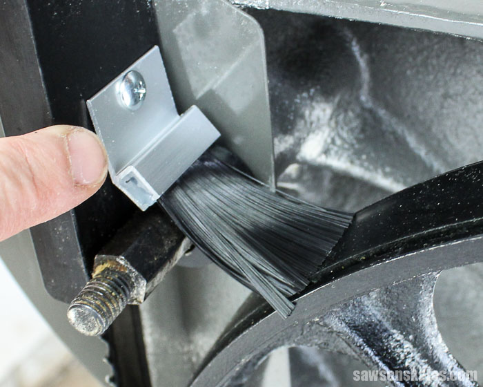 Bandsaw tips - add a brush to remove sawdust from the tire which will improve blade tracking and lengthen tire life
