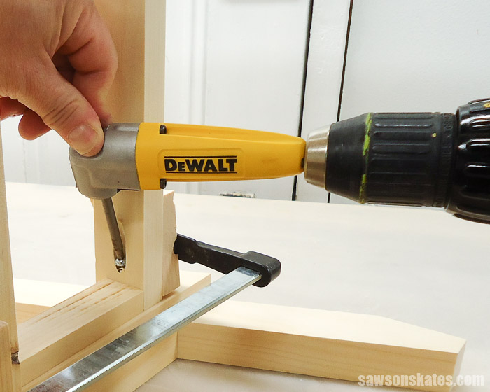 Using a DeWalt right angle attachment to reach a screw in a confined area