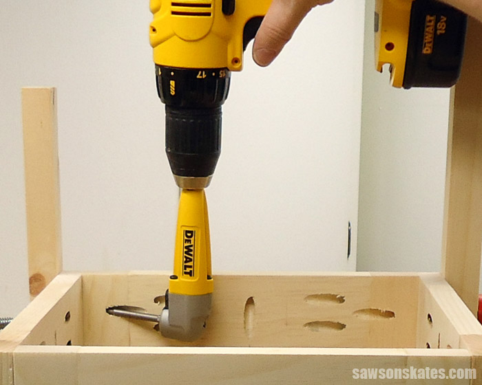 Using a right angle drill attachment to drive pocket screws into a tight spot