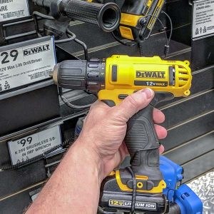DeWALT cordless drill in front of a power tool display