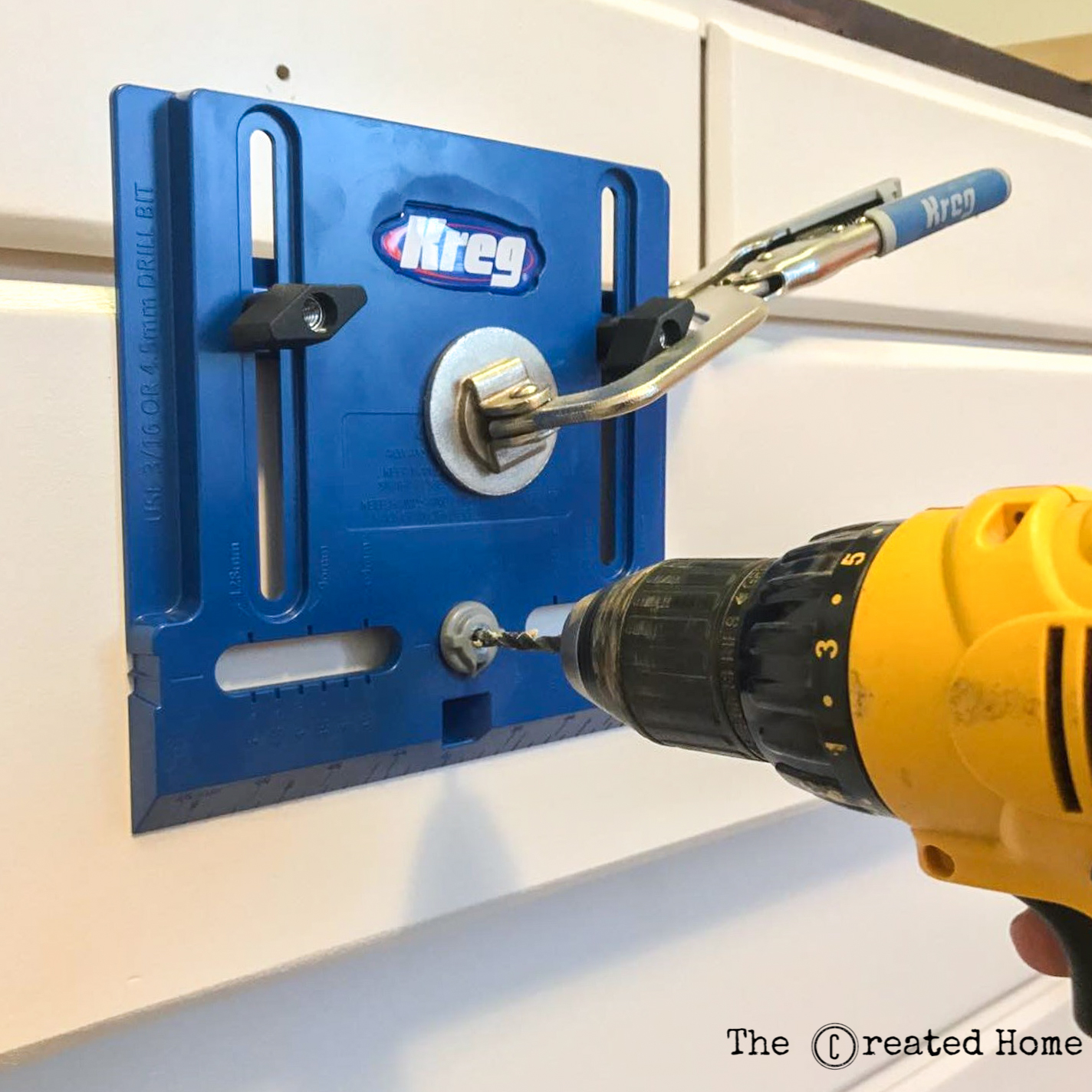 Using cabinet building tools like a Cabinet Hardware Jig makes quick work of drilling holes for pulls and knobs