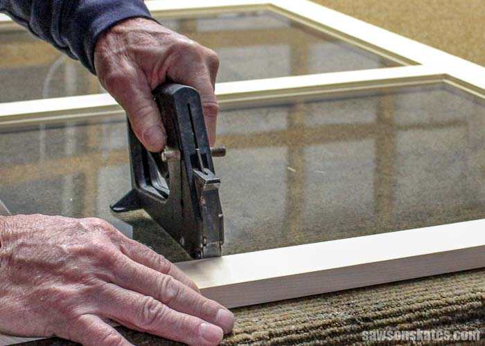 Glazier points hold the window in place before the window glazing can be added