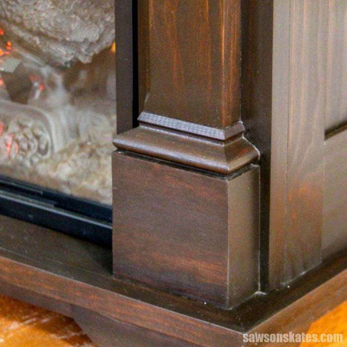This DIY electric fireplace surround has lots of decorative details and is also a TV stand