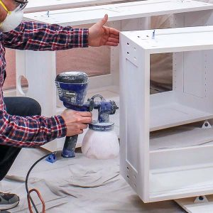 Using a sprayer indoors to paint furniture