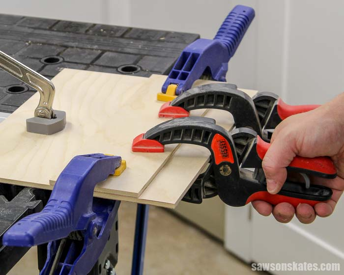 Clamping the fence on a circular saw cutting guide