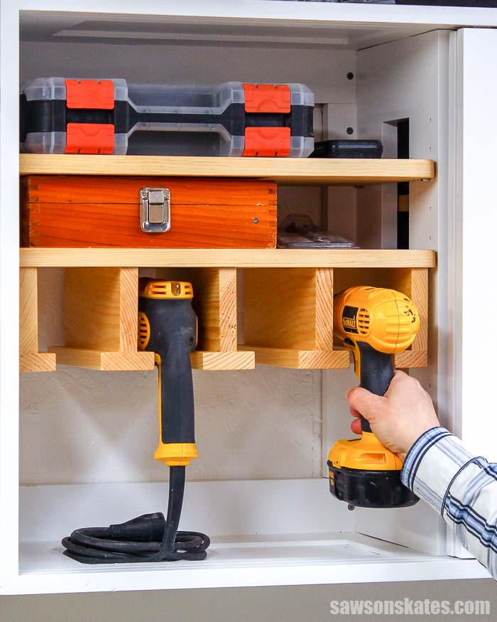 Make a DIY cordless drill storage rack with these free plans! It fits into a wall-mounted workshop cabinet and makes a great place for cordless tool storage.