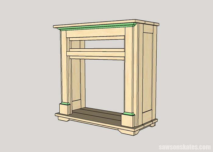 Attaching the molding to the DIY electric fireplace surround and TV stand