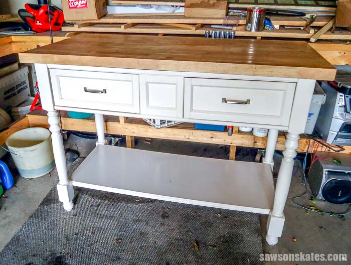 An old kitchen island was repurposed into a kitty litter cabinet