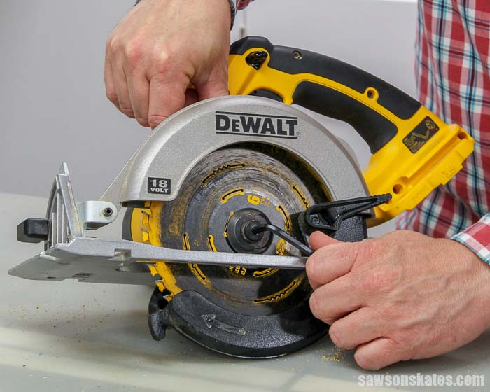 When learning how to change a circular saw blade it's important to know the screw must be turned to the right to loosen