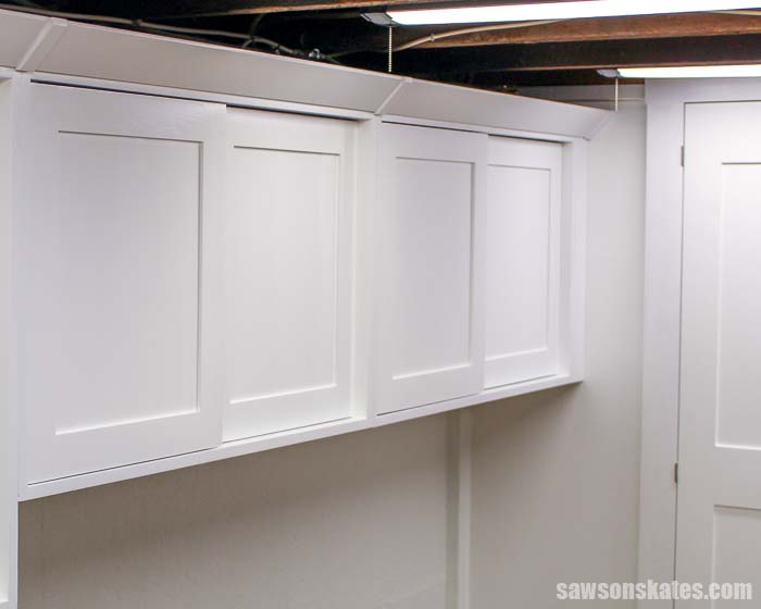 Shaker style crown molding made with a table saw has been installed on cabinets
