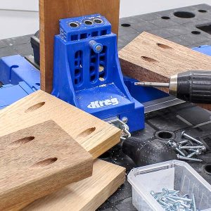 Kreg Pocket Hole Jig surrounded by hardwoods like cherry, oak, and mahagony