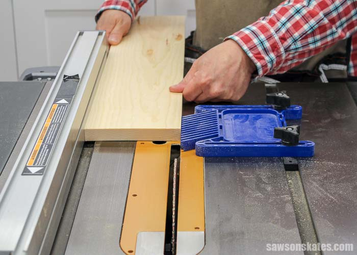 Improve table saw safety by placing a featherboard in front of the saw blade.