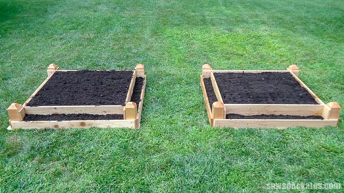 Two DIY tiered raised garden beds in the grass