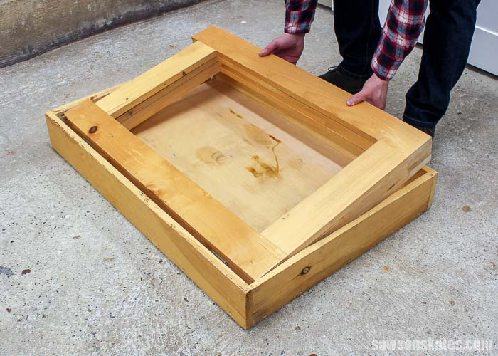 Placing the legs in the top of the DIY folding workbench