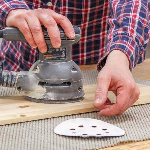 Reaching for a sanding disc that keeps flying off my orbital sander
