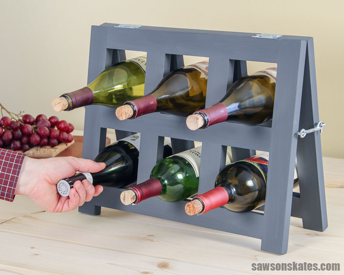 This small, countertop DIY wine rack is the perfect way to display wine bottles. It's easy to make, and the simple, modern design complements almost any decor.