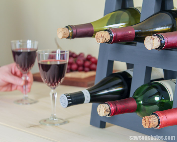 A do it yourself wine rack on a countertop with wine bottles and wine glasses