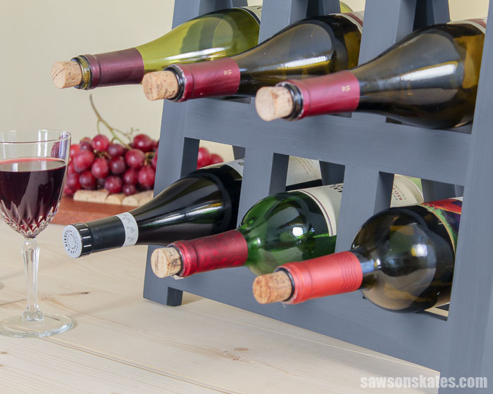 An easy to make DIY wine rack six bottles of wine and a wine glass