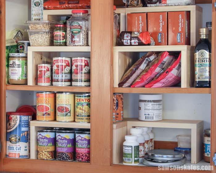 A kitchen cabinet organized with a DIY cabinet organizer shelf