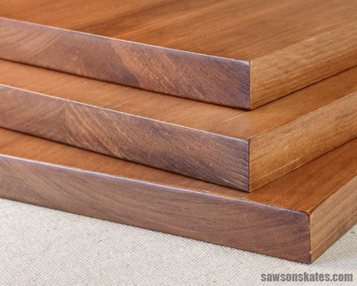 Three pine boards that have been stained with a DIY black walnut stain