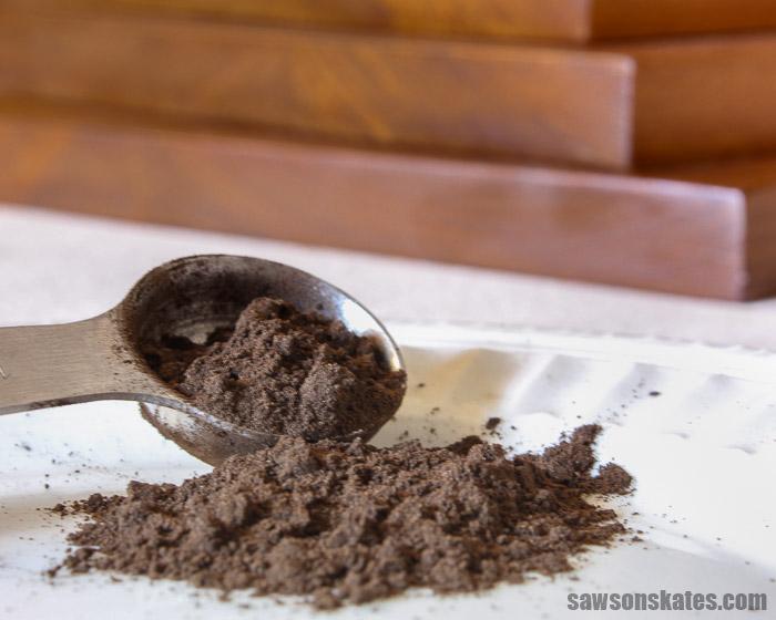 Walnut hull powder being used to make a DIY black walnut stain