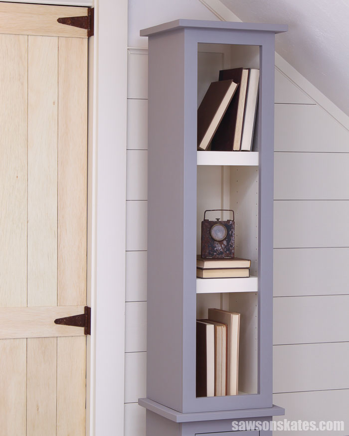 A wood DIY chimney cabinet with three shelves