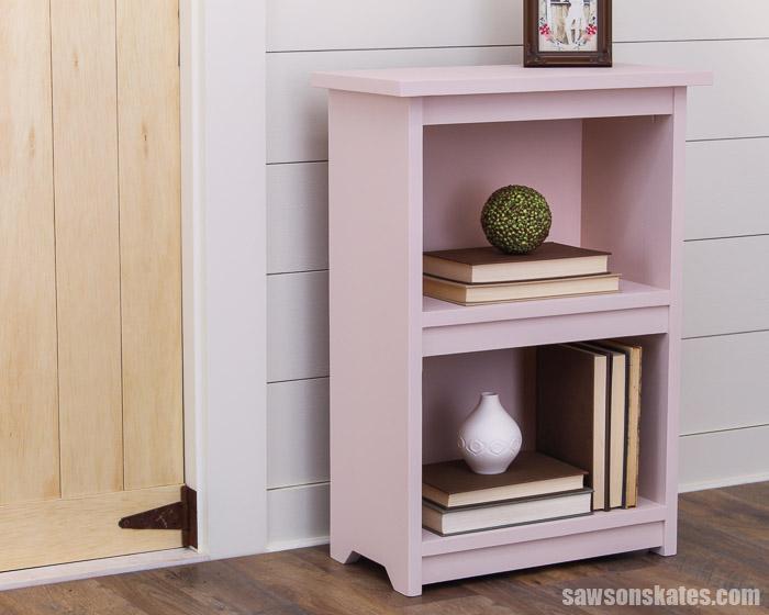 DIY bookshelf next to a wood door