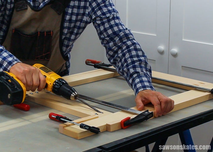 Assembling the sides of a wood DIY desk