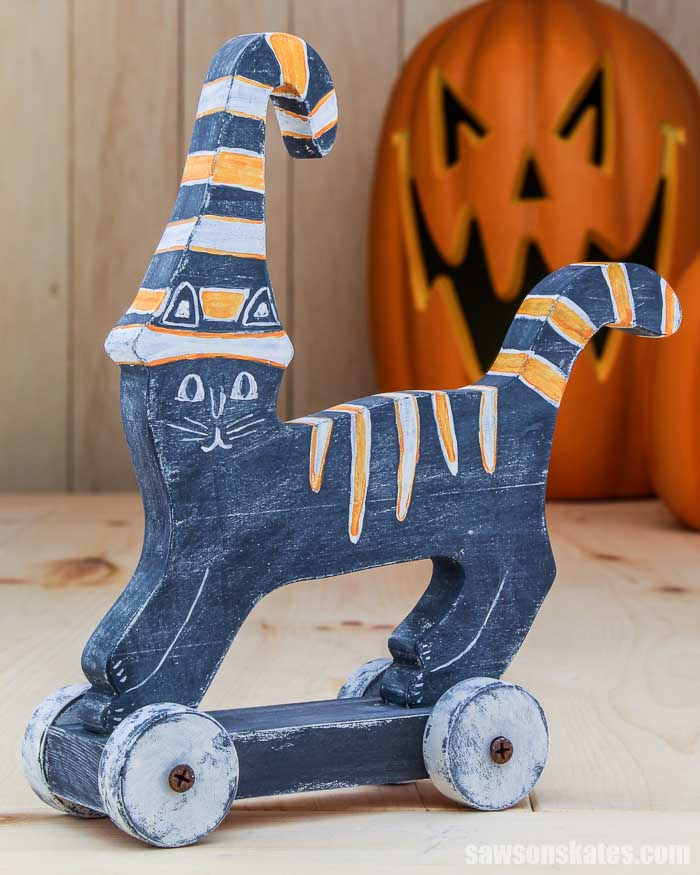 Decorate your haunted house with this retro-style DIY Halloween cat! Don't be scared. It's easy to make with scrap wood, paint, and this printable template.