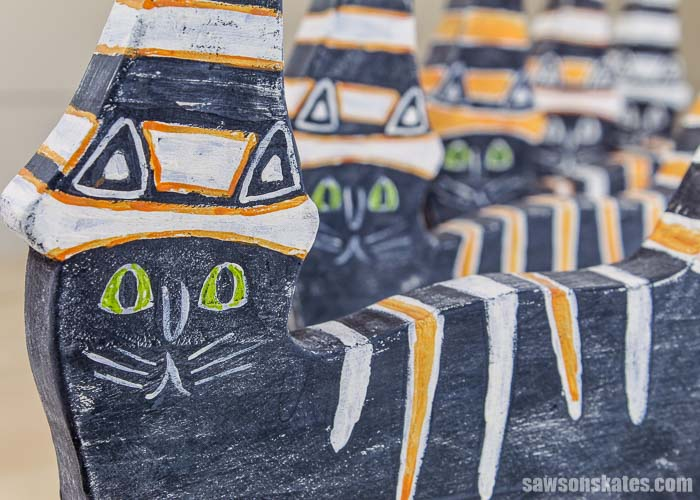 A row of five retro-style Halloween cat decorations