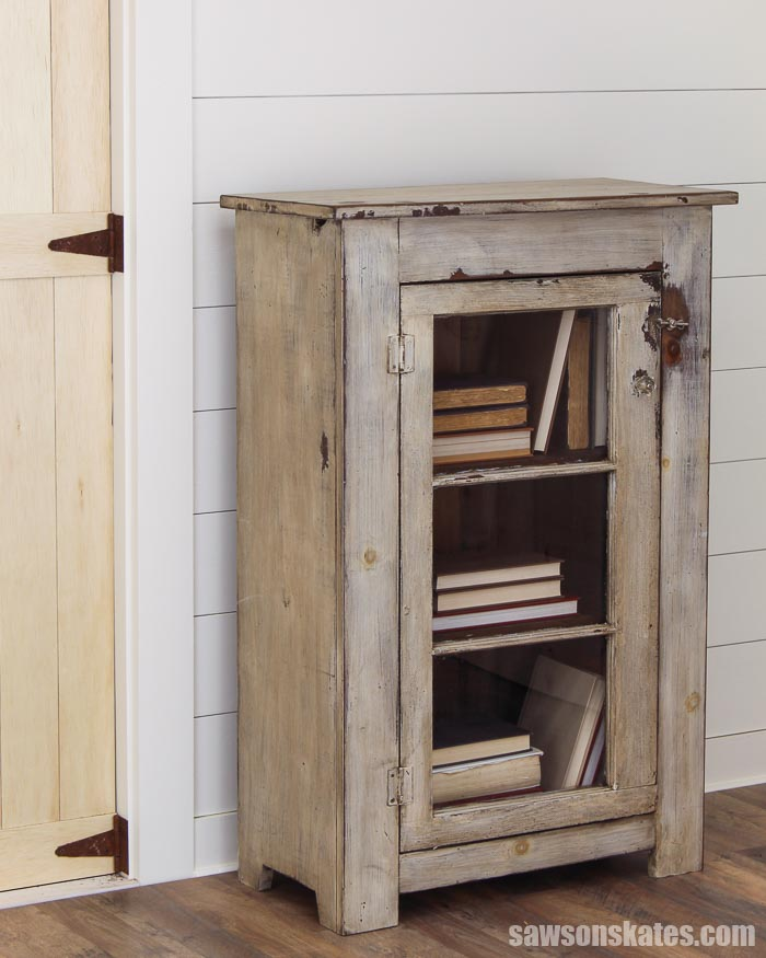 Don't toss that old window pane into a landfill. Upcycle it into a door for this rustic DIY window cabinet! It's easy to make and adds charm to any room.