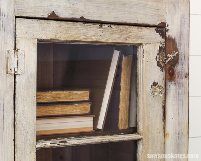 Window pane upcycled into a cabinet door