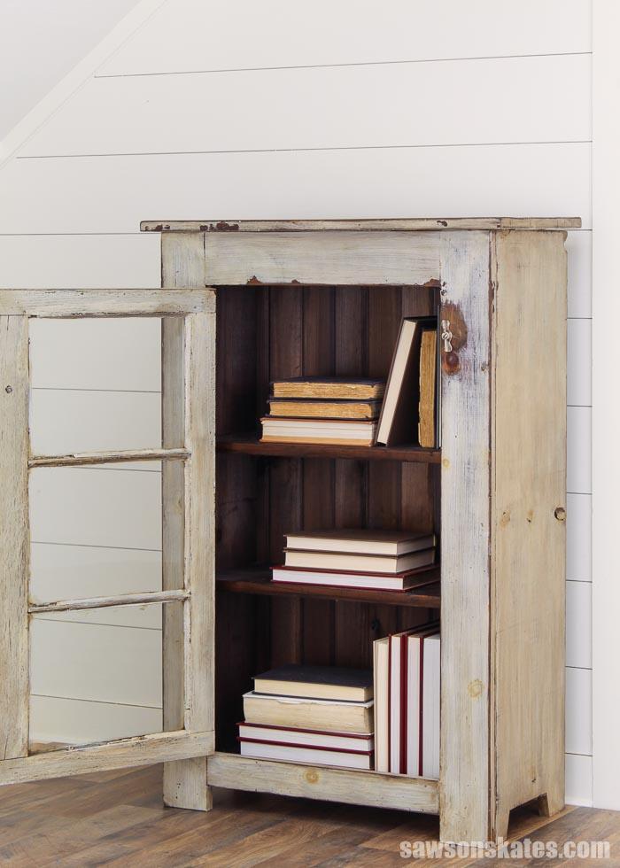 DIY window cabinet used as a bookshelf