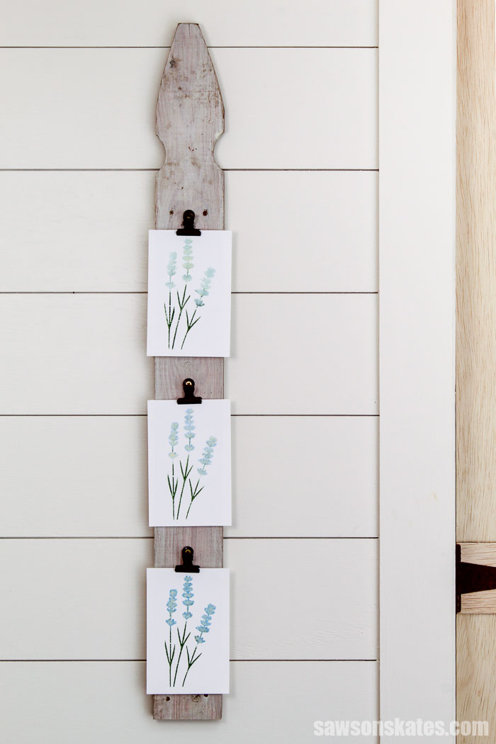 This DIY photo hanger is a clever way to display pictures without using frames. It's easy to make with one piece of scrap wood and one simple straight cut.
