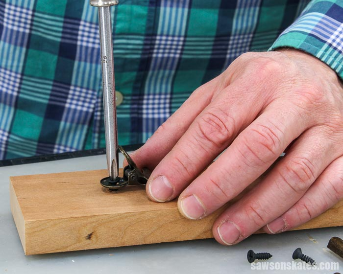Attaching a hinge clip with a screw to a DIY photo hanger
