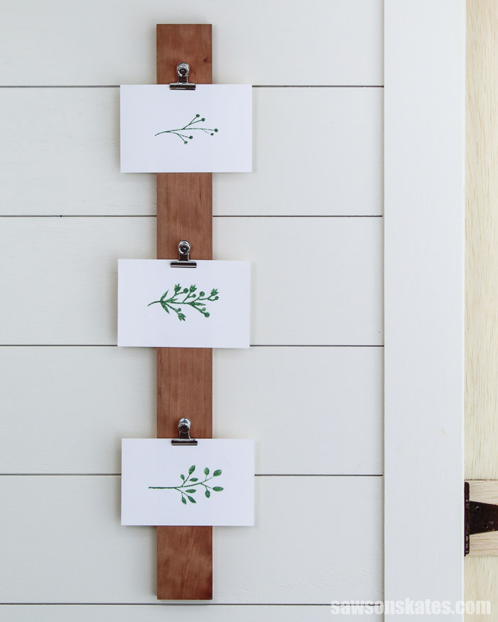 Three pictures displayed horizontally on a DIY photo hanger