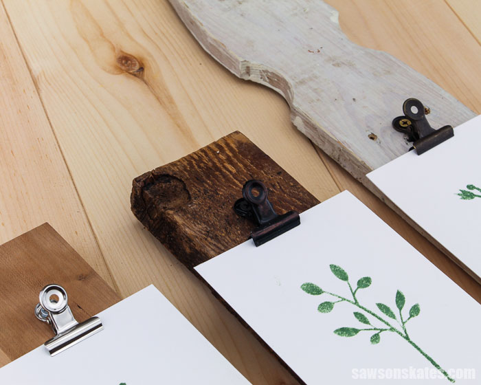 Three DIY photo hangers made with cherry wood, barn wood, and a repurposed fence picket