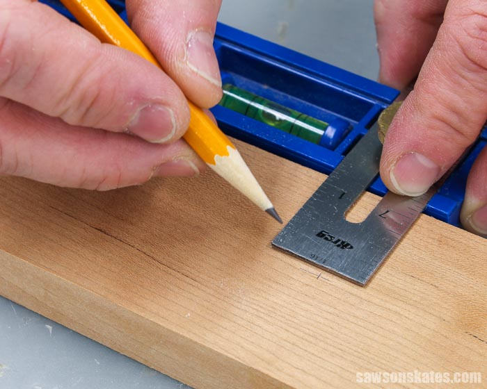 Marking the location for a hinge clip on a DIY photo hanger