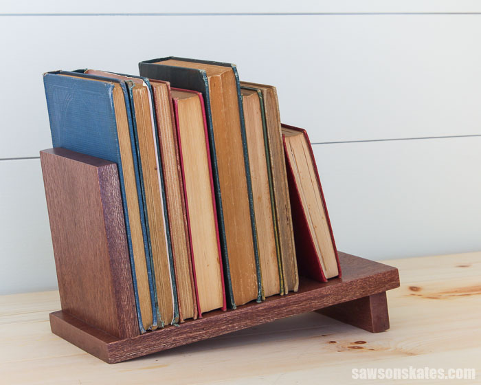 Get your books organized with this DIY tabletop book rack. It's simple to make with just three pieces of wood, four screws, and these easy to follow plans.