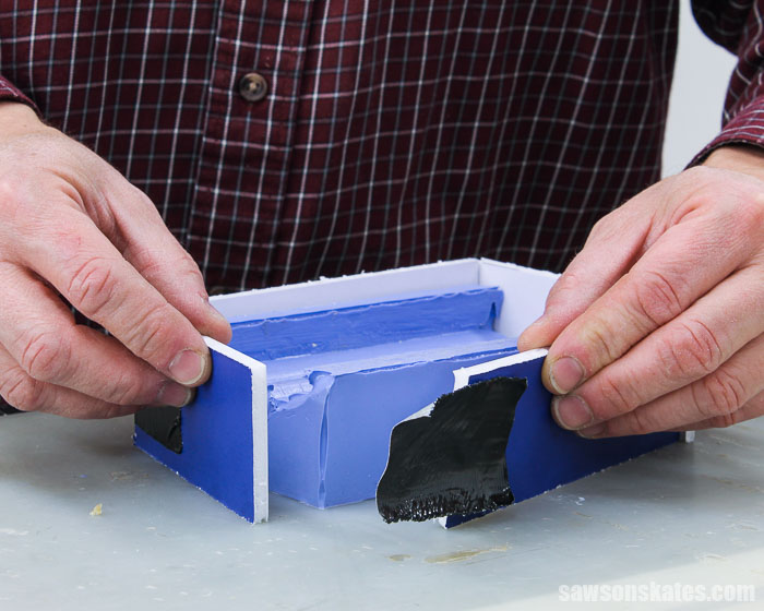 Wrapping a silicone rubber mold with foam board to pour a replacement piece of molding