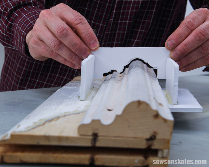 Fitting a piece of foam board to duplicate a section of molding